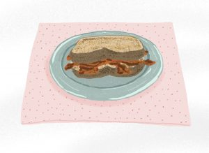 An illustrated bacon sandwich on a light blue plate and pink dotted placemat.