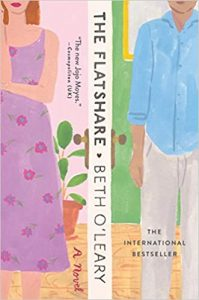 An illustrated cover with the title, The Flatshare, and author, Beth O'Leary running vertically down the middle, bisecting an image of a man and woman with their feet and heads cropped off.