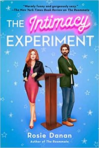 A blue book cover the says The Intimacy Experiment and Rosie Danan with a bearded man and a woman in a red dress standing on either side of a podium.