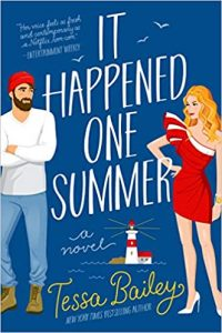 A blue illustrated book cover with a blond woman in an off-the-shoulder red cocktail dress and white heels and a man in a red beanie, white long-sleeved shirt, jeans, and boots. There are birds in the sky, water lines, and a lighthouse in the background. The title is It Happened One Summer, and the author is Tessa Bailey.