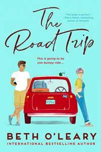 """An aqua-colored book cover with an illustrated young man and woman leaning on opposite sides of a red Mini Cooper with luggage inside. She's wearing overalls and has short, purple hair. He's in khaki shorts and a white t-shirt with brown hair, looking over the roof of the car at her. The title is The Road Trip in script at the top with the author, Beth O'Leary printed at the bottom. The tag line reads, """"This is going to be one bumpy ride."""""""
